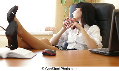 Relaxed Business Woman With A Cup Of Coffee