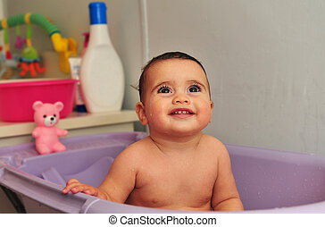 Concept Photo - Baby - Cute baby bath in a purple bathtub