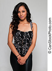 Latina - Pretty young Latina in a black sleeveless top