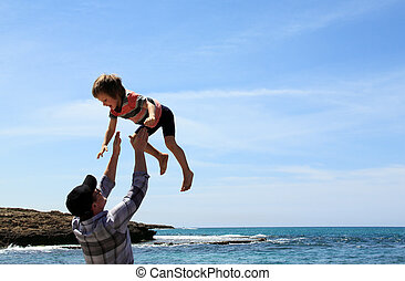 Happy father and son on the beach