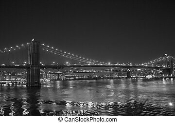 Lights of New York City and Brooklyn Bridge at Sunset