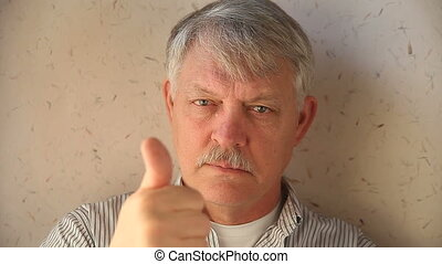older man with thumbs up