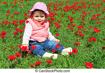 Concept Photo - Flowers and Spring Time - A baby girl child...