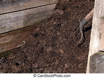 Compost pile - Working in the garden: compost pile with a...
