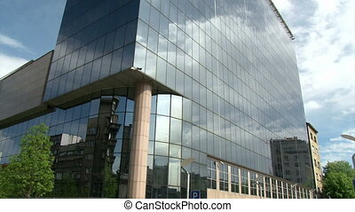 Building, bank, glass windows, low angle shot