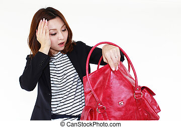 Anxiety woman - Woman searching for something in her bag