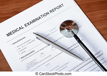 Medical Report - Medical report blank form with pen and...