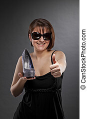 woman with sunglasses and shoe