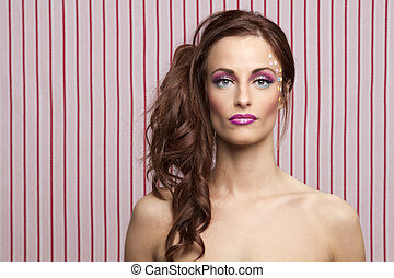 Candy doll - Young woman with colorful makeup and star candy...