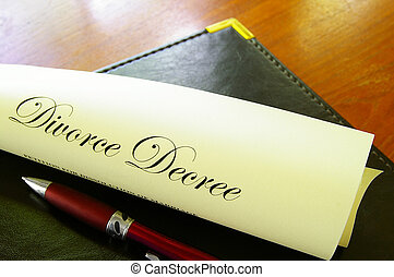 Closeup of a divorce decree, rolled up with pen