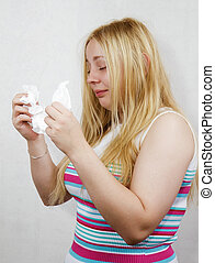 cold blonde girl with the handkerchief on a white background