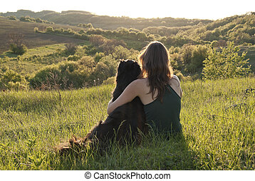 Unconditional Love - A beautiful young woman hugs her dog as...