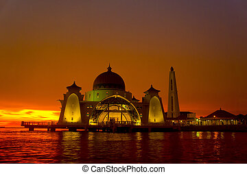 selat mosque with dramatic sunset