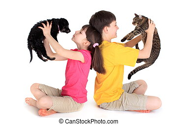 Children with family pets. - Brother and sister sit back to...