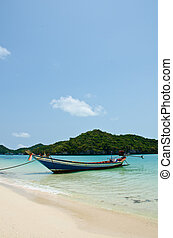 long tail boat on the beach