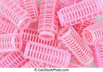 Pink Hair Curlers - Plastic pink hair curlers in a random...