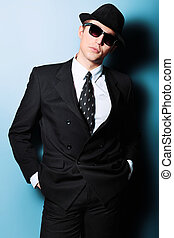 Portrait of a handsome young man in a suit. Shot in a studio.