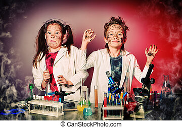 crazy students - Two children making science experiments....