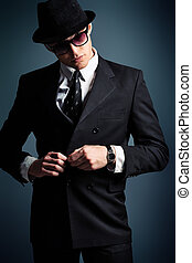 boss - Portrait of a handsome young man in a suit. Shot in a...
