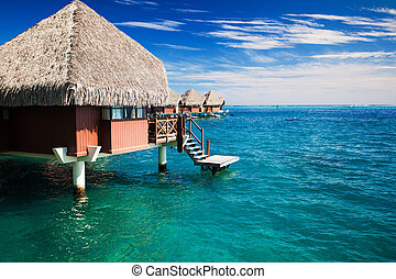 Over water bungalow with steps into clear ocean - Over water...