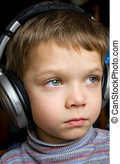 Little boy in ear-phones - The little boy in ear-phones...