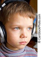 Little boy in ear-phones - The little boy in ear-phones...
