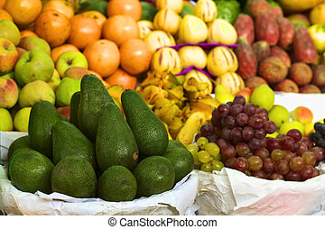 Peruvian Market - Avocado and other fruits such as grapes,...