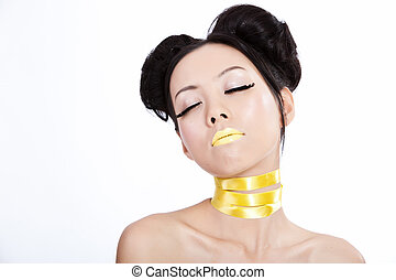 Young asian female with creative yellowl makeup