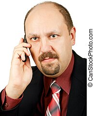 Serious businessman with crazy eyes talking by mobile phone,...