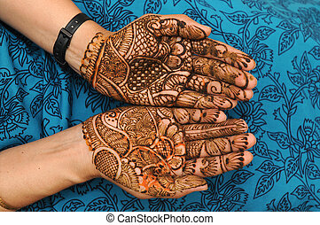 mehandi - a design on hands against a black background