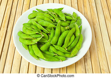 green bean vegetable on wood background