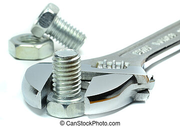 Adjustable wrench - An adjustable wrench with nut and bolt...