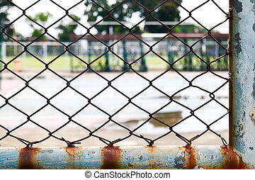 old wire fence in the tennis court