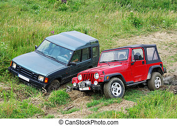 Off-road competition - Two off-road cars in competition