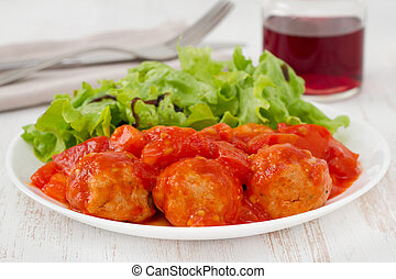 turkey meatballs with tomato paste on the plate