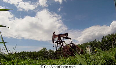 Oil rig in the middle of nature - Oil rig extracts resources...