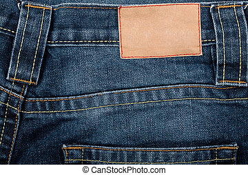 Blank leather jeans label sewed on a blue jeans
