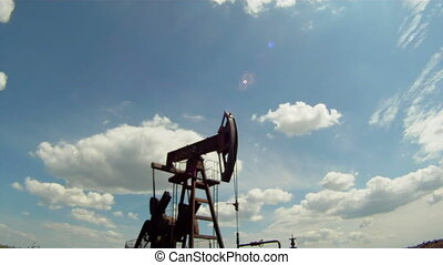 use of natural resources - Oil rig extracts resources from...