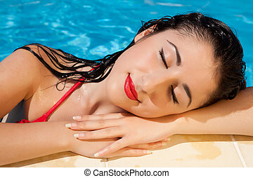 Woman resting after a swim