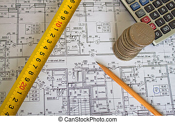 House Plans with a pencil, a calculator, a coin, ruler