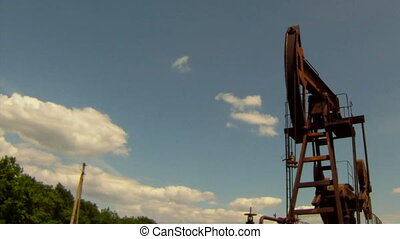 Pump oil - Oil rig extracts resources from the earth. In the...