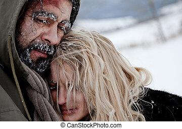 Freezing homeless couple hugging - Close-up of freezing...