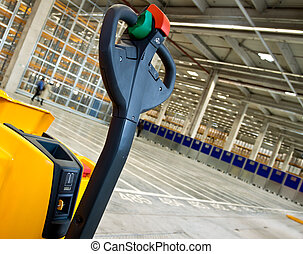Cropped forklift in warehouse