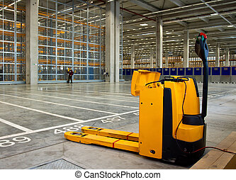 Electric forklift in storehouse - Electric forklift in large...