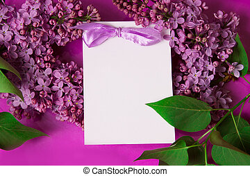 Purple lilac with invitation over violet background