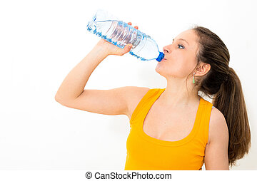 Young woman drinking water against white background