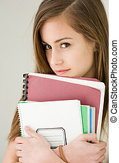 Pretty young brunette student girl - Portrait of a pretty...