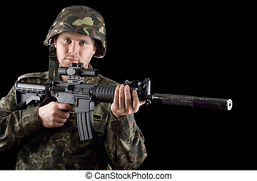 Alerted soldier holding m16