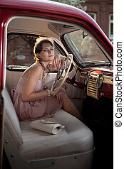 Woman in the vintage car - Pretty woman is sitting in the...