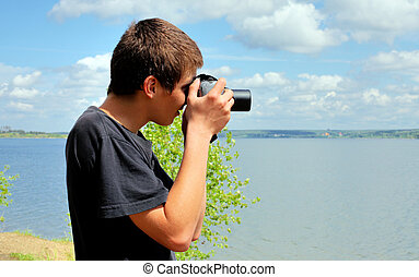 young man with camera - young man with digital photo camera...